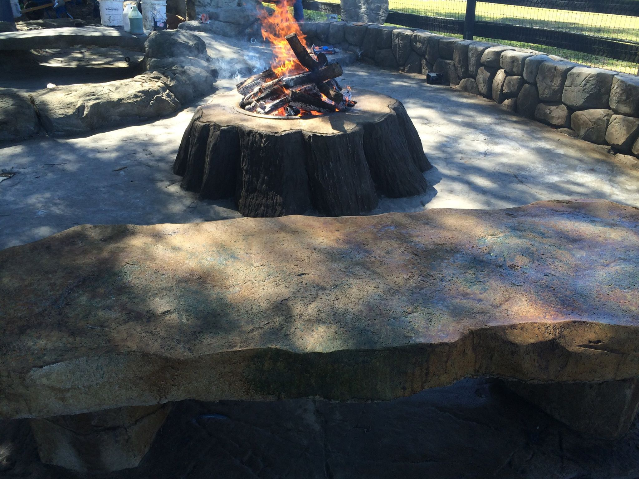 Firepit with burning Logs Stacked High