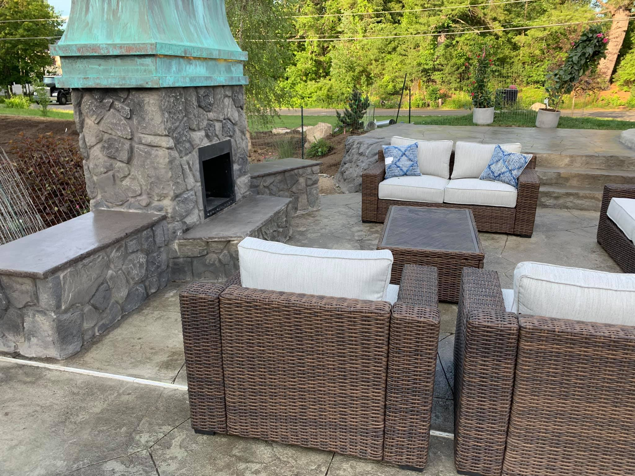 dugybear outdoor living Outdoor fireplace with chairs surrounding