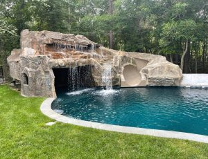 Pool slide with waterfall and cave